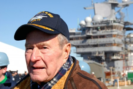 080125-N-2510R-005  NEWPORT NEWS, Va. (Jan. 25, 2008) Former President George H. W. Bush looks down the flight deck of the Precommissioning Unit (PCU) George H.W. Bush (CVN 77) during the shipÕs catapult testing ceremony. Bush was the ceremonyÕs honorary guest who signaled the launch of a Òdead loadÓ off the deck of (PCU) Bush. ÒDead LoadÓ launches test the shipÕs catapult systems ability to launch aircraft. The ship is under construction at Northrop Grumman Newport News Shipyard. U.S. Navy photo By Mass Communication Specialist 1st Class Narina Reynoso (Released)