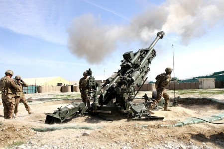 Artillerymen from 3rd Battalion, 320th Field Artillery Regiment, 3rd Brigade Combat Team, 101st Airborne Division (Air Assault) conduct M777A2 Howitzer training with precision guided munitions March 19, 2015, at Operational Base Fenty in Afghanistan. (U.S. Army photo by Capt. Charlie Emmons, Train Advise Assist Command-East Public Affairs)